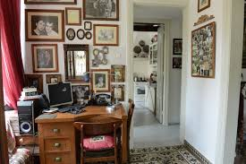 neoclassical charm rhodes sotheby international realty the study walls are decorated with old family photos house