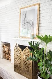 using all five senses at home thou swell simple living room white brick fireplace design with chesapeake bay candle on the mantel on thou