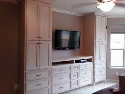image of bedroom wall units with drawers and tv wardrobe