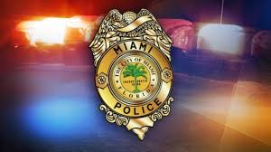 2 miami police officers state corrections officer charged