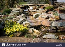 Rock Garden With Water Feature A New Small Garden Water Feature Using Slate Rocks Stock