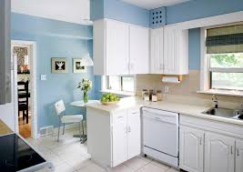 soft blue wall color with classic white cabinet for small kitchen