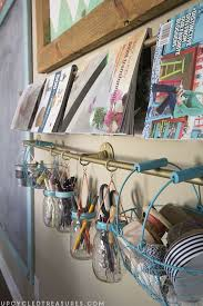 Storage Ideas For Craft Room - gold pipe hanging storage for craft room hometalk