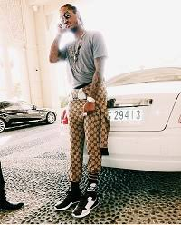 gucci jumpsuit future wears a gucci brown wool gg supreme jumpsuit from the