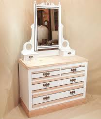 Dark Wooden Table Top Gray Painted Room Wall With White Wooden Mirror Dressing Table On
