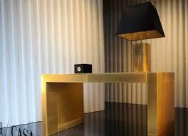 38 500 giorgio armani gold plated desk laughs in the face of