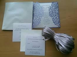 romantic lavender laser cut wedding invitations with grey ribbon