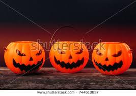 plastic pumpkins scary plastic pumpkins on stock photo 744610897