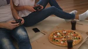 Young Couple Room Hungry Young Couple Eating A Pizza On The Floor Of The Living Room