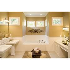beige bathroom wall paint and white ceramic pedestal bathroom