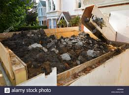 machine removing soil from basements excavation excavating the