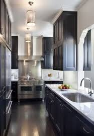 Black Kitchens Black Kitchen Cabinets White Counters Brass Gold Faucet And