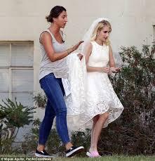 2 wedding dress spotted wearing white lace wedding dress on set of