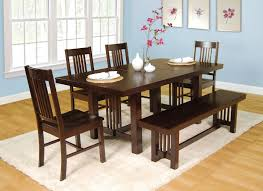 brown polished wooden dining bench with dining table and chairs on
