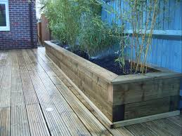 image result for built up garden borders with decking patio wall