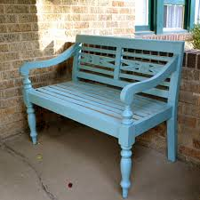 exterior wrought iron porch bench with carved back and wooden