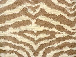 drapery upholstery fabric chenille animal print tiger in tan on cream