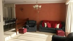 what colour to paint walls to go with dark blue leather couches