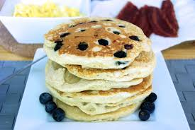 banana and blueberry pancakes two red bowls