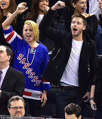 new york rangers fans margot robbie enthusiastically cheers for new york rangers during