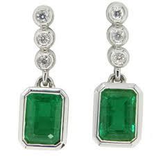 emerald earrings uk rectangular cut emerald brilliant cut diamond pendant earrings
