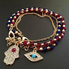 charm bracelet with evil eye images Glod evil eye charm bracelet red and blue beads with hamsa hand jpg