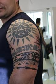 polynesian sun on shoulder designs pictures