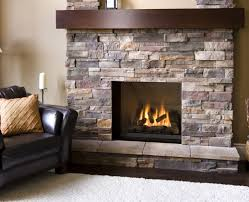 natural stone veneer firepalce with dark wood mantel home decor