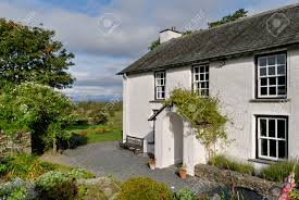 English Country Cottages A Typical Whitewashed Country Cottage Set In Open Countryside
