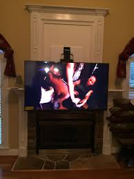 mounting flat screen tv covering old fireplace niche charlotte