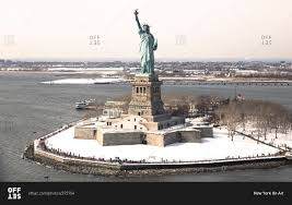 the statue of liberty and liberty island in winter new york city