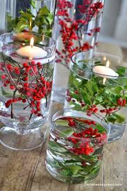 christmas candle centerpiece ideas clear glass vases berries and greenery and floating candles