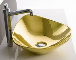 scarabeo u0027s gold bathroom fixtures showers you with bling
