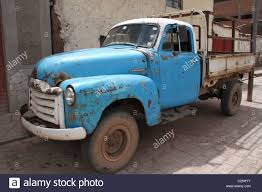 rusty pickup truck rusty old blue pickup truck on a brick road stock photo 35795871