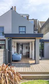 modern flat roof corner opening timber decking terrace