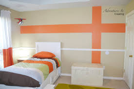 Orange Accent Wall by Boys Bedroom With Orange Accents