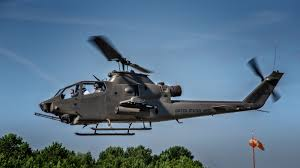 bell ah 1f huey cobra attack helicopter in flight