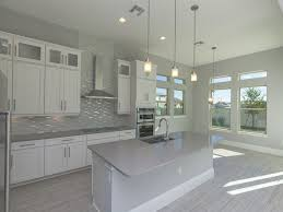 kitchen with flush u0026 travertine tile floors in orlando fl