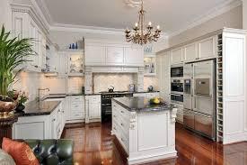 shabby chic beige cabinets beautiful backsplash lighting kitchen