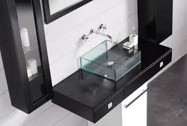 bathroom with wall mounted chrome faucet and square glass sink