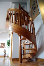 Staircase Design Inside Home by Striking Spiral Staircase Kits That Painted In Brown Blended With