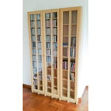 ikea bookcase with doors ikea gnedby cd dvd book shelves with glass doors 1509clearout