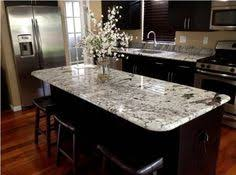 Black Cabinet Kitchens by Alaskan White Granite Countertops Paired With Black Cabinets
