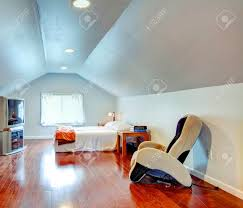 light blue low and vaulted ceiling bedroom with hardwood floor