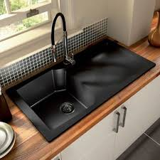 black countertop with black sink design trends incorporating black stainless steel into your kitchen