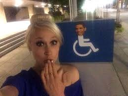 Drake In A Wheel Chair Drake U0027s Face Plastered On Wheelchair Signs In Toronto Meme Explained