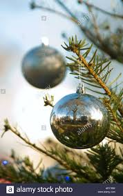 vertical close up of christmas baubles and lights decorating a