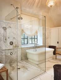 luxury bathroom with freestanding tub and glass shower stall with