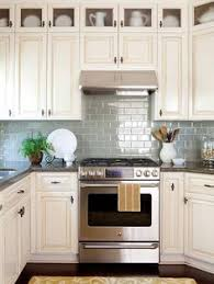Kitchen Idea Of The Day Creamy Subway Tile Backsplash Behind The - Kitchen backsplash ideas with cream cabinets