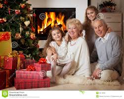 grandparents with grandchildren celebrating christmas royalty free